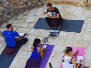Arun teaching yoga students